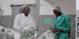 Photo: Monica Musonda, CEO Java Foods shares a joke with colleague as they package Supa Cereal Bags